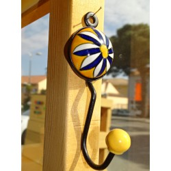 orange round ceramic coat hook with blue ultramarine flower