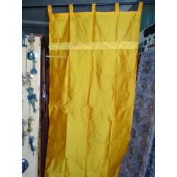 Bright orange taffeta curtains with a brocade band