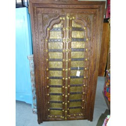 Old cabinet doors decorated with elephant motifs brass plates