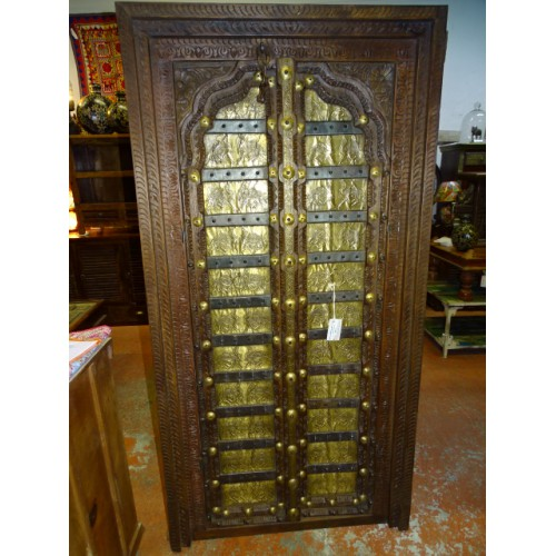 Old cabinet doors decorated with camel motifs brass plates