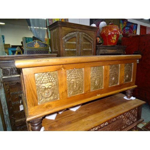 Teak and brass blanket chest with Buddha heads
