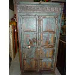 Large cabinet with old lintel and old turquoise doors