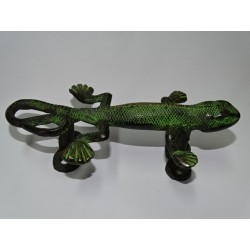 bronze handle in the shape of a green patinated salamander