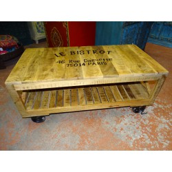 Coffee table with industrial recycled teak with trolley wheels