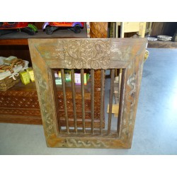 Indian grille window with carved flower on top